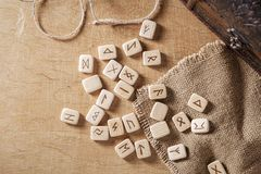 Handmade scandinavian wooden runes on a wooden vintage background. Concept of fortune telling and prediction of the.  royalty free stock images