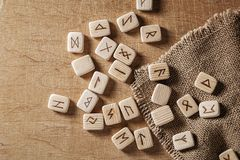 Handmade scandinavian wooden runes on a wooden vintage background. Concept of fortune telling and prediction of the.  stock photo