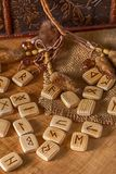 Handmade scandinavian wooden runes on a wooden vintage background. Concept of fortune telling and prediction of the.  royalty free stock photo