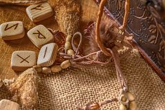 Handmade scandinavian wooden runes on a wooden vintage background. Concept of fortune telling and prediction of the.  royalty free stock photography