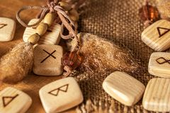 Handmade scandinavian wooden runes on a wooden vintage background. Concept of fortune telling and prediction of the.  stock photos