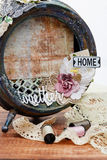 Handmade scrapbooking photo frame. Beautiful handmade photo frame with paper details made from vintage alarm clock. Scrapbooking. Fragment Stock Image