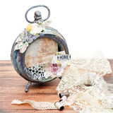 Handmade scrapbooking photo frame. Beautiful handmade photo frame with paper details made from vintage alarm clock. Scrapbooking. Isolated on white. Copy space Royalty Free Stock Photography