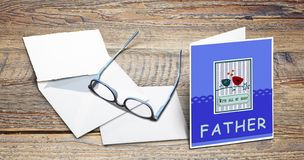 Handmade scratch greeting card with Happy Father day text. On wooden table stock photo