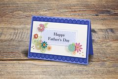 Handmade scratch greeting card with Happy Father day text. On wooden table stock images