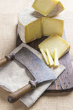 Handmade sheep cheese on the cutting board Royalty Free Stock Photos