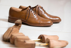 Handmade shoes and shoe stratchers Royalty Free Stock Image