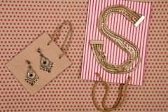 handmade shopping bags of craft paper, gift bags and gold women& x27; royalty free stock images