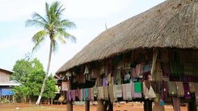 Handmade silk cotton clothes in lao village,Pakse,Laos stock video