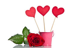 Handmade skewers with cloth hearts and beautiful red rose Royalty Free Stock Image