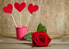 Handmade skewers with cloth hearts and beauty red rose. For celebration  on wooden background Stock Images
