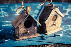 Handmade small bird house in wooden workshop Stock Photos