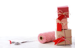 Handmade small boxes with scissors and spool. On white background Royalty Free Stock Photos