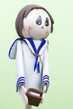 Handmade Small Figure of Little Boy Dressed for First Communion. Royalty Free Stock Photo