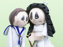 Handmade Small Figures of Children Dressed for First Communion Stock Images