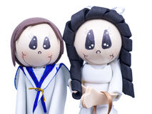 Handmade Small Figures of Children Dressed for First Communion Stock Photos