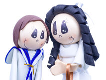 Handmade Small Figures of Children Dressed for First Communion Stock Image