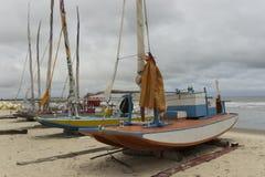 Handmade small fishing boats - Genipabu beach in Natal, RN, Brazil Royalty Free Stock Photos