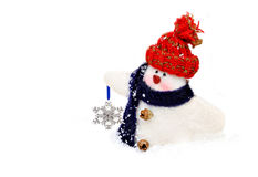 Handmade snowman carrying a snowflake Royalty Free Stock Photo