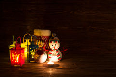 Handmade snowman, lamp with a candle and Christmas decoration. Royalty Free Stock Images
