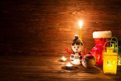 Handmade snowman, lamp with a candle and Christmas decoration. Stock Image