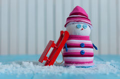 Handmade snowman in marsala color sweater with red Royalty Free Stock Image