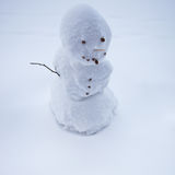 Handmade snowman in snow Royalty Free Stock Photo