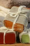 Handmade soap. Three handmade soap on a bamboo mat Stock Images