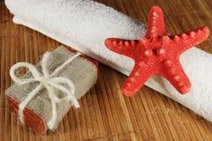 Handmade soap. And towel on bamboo mat Stock Photos