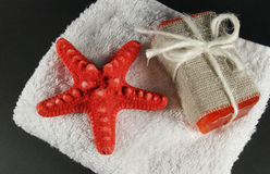 Handmade soap. And towel on black Royalty Free Stock Photo