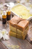 Handmade Soap and Aroma Oil with Flower branch. Spa products. Royalty Free Stock Photo
