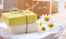 Handmade soap bars and chamomile on wooden background Stock Photography