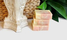 Handmade Soap Bars with greenery and basket. 3 unlabeled bars handmade bare soaps with greenery, basket and candle stick Royalty Free Stock Photo