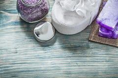 Handmade soap bath sponge scented sea salt jar cover on wooden b royalty free stock photo