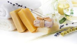 Handmade Soap with bath towels on white stock image