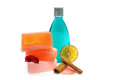 Handmade soap, blue colored shower gel bottle and cinnamon. Stock Photo