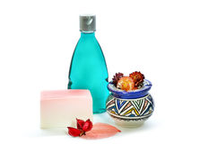 Handmade soap, blue colored shower gel bottle and vase. Royalty Free Stock Photo