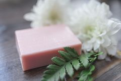 Handmade soap closeup and white flowers in defocus.  Royalty Free Stock Photos