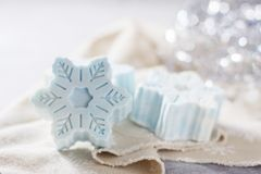 Handmade soap in the form of snowflakes, natural cosmetics concept. Place for text. Selective focus stock photography