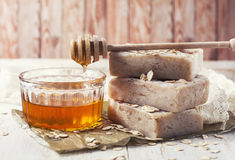 Handmade soap with honey and oatmeal. Selective focus Stock Photos