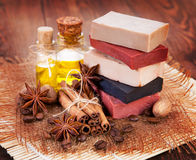 Handmade soap, oil in bottles anise and cinnamon stock photos