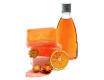 Handmade soap, orange colored shower gel bottle Royalty Free Stock Photos