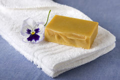 Handmade Soap with a Purple Petunia Flower Royalty Free Stock Photo
