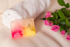 Handmade soap and roses on white leather background Royalty Free Stock Image