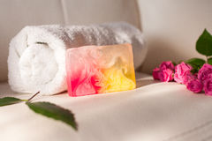 Handmade soap and roses on white leather background Stock Images