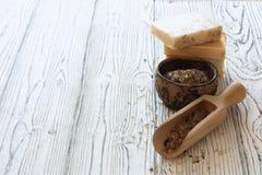 Handmade soap and sea salt over natural wood backfground Royalty Free Stock Photography