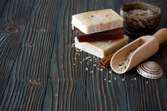 Handmade soap and sea salt over natural wood background Royalty Free Stock Images