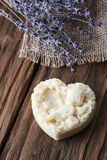 Handmade soap in the shape of a heart with angel Stock Photos