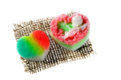 Handmade soap in the shape of a heart and rose on a napkin Royalty Free Stock Photo