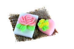 Handmade soap in the shape of a heart and rose on a napkin Royalty Free Stock Photography